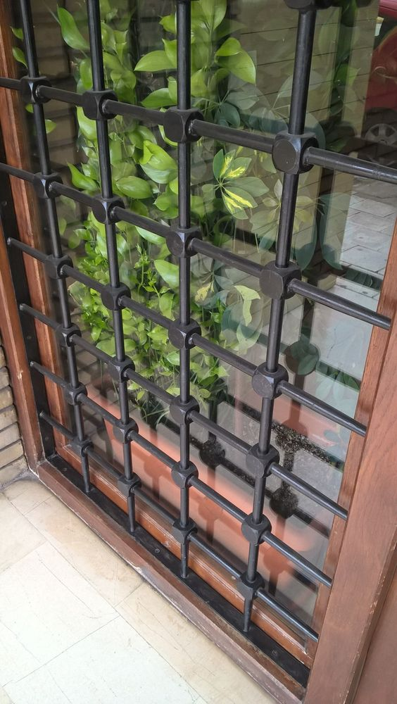 Simple Yet Modern Window Grill Designs to Decorate Windows 4